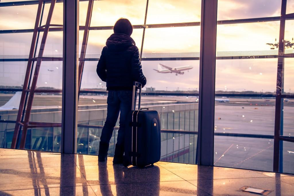 bigstock-Traveler-silhouettes-at-airpor-52479226-1024x682